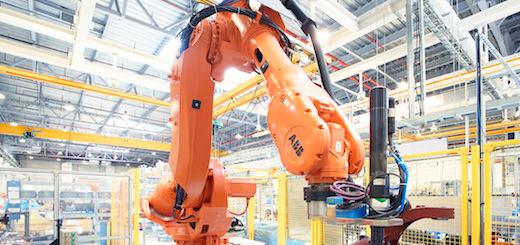 A robot assembles robots